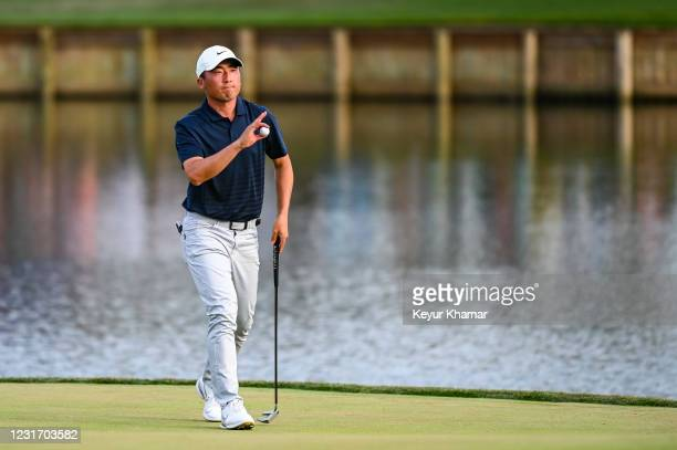 Doug Ghim waves his ball to fans on the 17th hole green during the third round of THE PLAYERS Championship on the Stadium Course at TPC Sawgrass on...