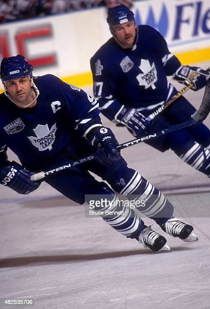 Doug Gilmour and Wendel Clark of the Toronto Maple Leafs skate on the ice during an NHL game against the New York Rangers on December 6 1996 at the...