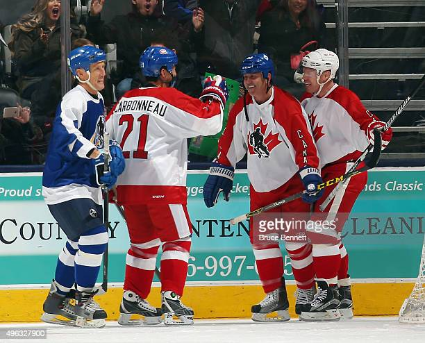Doug Gilmour celebrates his goal along with Guy Carbonneau and Kris Draper at the Legends Classic game at the Air Canada Centre on November 8 2015 in...