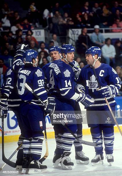 Doug Gilmour Dave Andreychuk Wendel Clark Ken Baumgartner and Dmitri Mironov of the Toronto Maple Leafs celebrate Andreychuk's goal during an NHL...