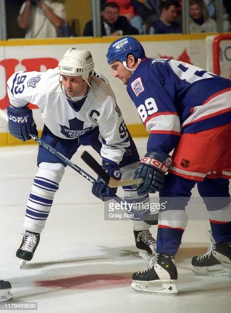 Doug Gilmour of the Toronto Maple Leafs skates against Darren Turcotte of the Winnipeg Jets during NHL game action on November 18, 1995 at Maple Leaf...