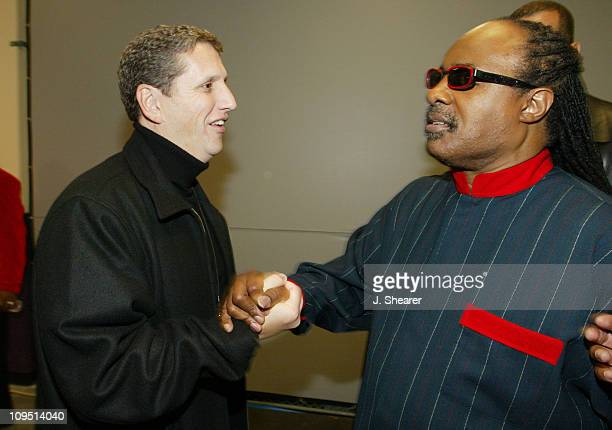 Doug Herzog President of USA Networks meets Stevie Wonder backstage at USA Network's A Motown Christmas airing December 8th