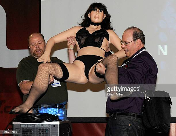 Doug Hines owner and designer for TrueCompanion has help carrying Roxxxy a prototype of what Hines said is the world's first female sex robot...