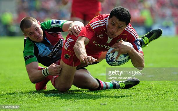 Doug Howlett of Munster beats the tackle of Mike Brown to score a try during the Amlin Cup semi-final match between Munster and Harlequins at Thomond...