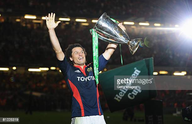 Doug Howlett of Munster celebrates with the trophy following the Heineken Cup Final between Munster and Toulouse at the Millennium Stadium on May 24,...