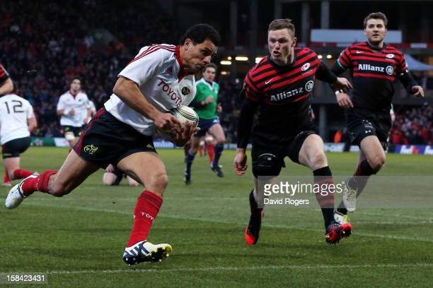 Doug Howlett of Munster outpaces Chris Ashton of Saracens to score a try during the Heineken Cup pool one match between Saracens and Munster at...