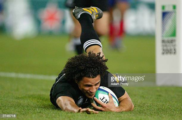 Doug Howlett of New Zealand scores a try during the Rugby World Cup PlayOff match between France and New Zealand at Telstra Stadium November 20 2003...