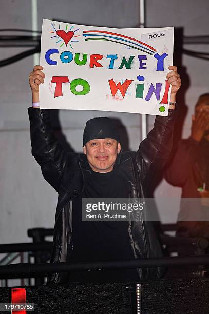 Doug Hutchison holds up a poster in support of his wife Big Brother housemate Courtney Stodden as Dustin Diamond is evicted from the Celebrity Big...
