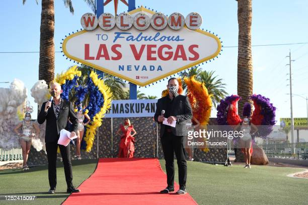 Doug Johnson and Greg Chase speak during a Mask Up for Nevada fashion show at the Welcome to Fabulous Las Vegas sign on June 25 2020 in Las Vegas...