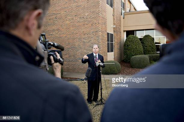 Doug Jones Democratic US Senate candidate from Alabama speaks to members of the media following a tour of the Northport Medical Center in Northport...