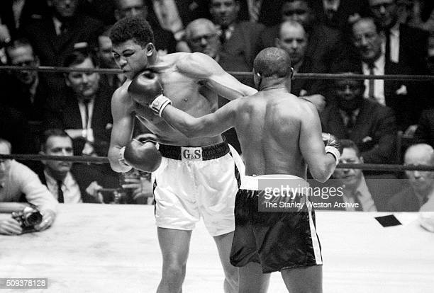 Doug Jones in action throwing a left hook vs Cassius Clay during their heavyweight bout at Madison Square Garden New York New York March 13 1963 NO...