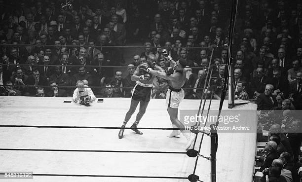 Doug Jones lands a hard left on Cassius Clay during their heavyweight bout at Madison Square Garden New York New York March 13 1963