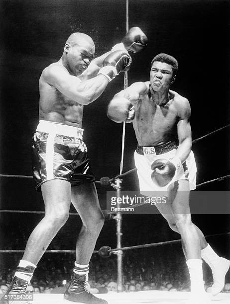Doug Jones throws up his hands as Cassius Clay lets fly a roundhouse right during their 10round heavyweight contenders bout at Madison Square Garden...