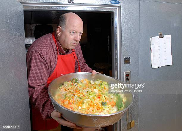 Friday April 11 2008 Jeff Estabrook Executive Director of Wayside Programs does double duty at the Wayside Soup Kitchen Friday night prepping the...