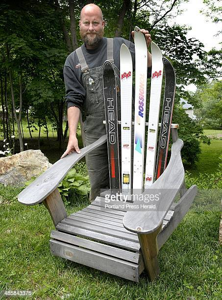 Thursday June 11 2009 James Omo shows off his 'funky' Adirondack chair with skis for a back at his home in Bath