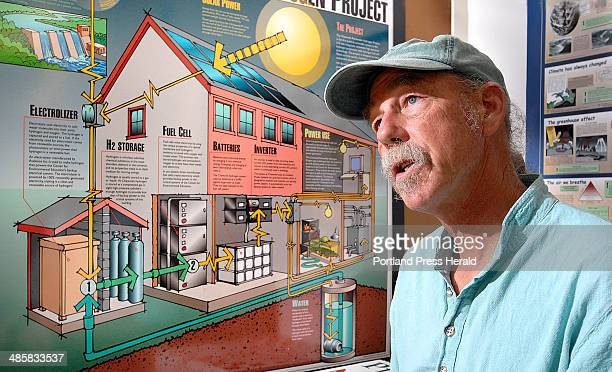 Wedesday June 18 2008 Peter Arnold stands in front of a diagram of the Chewonki Foundation's hydrogen oxygen fuel cell powered backup system Hydrogen...