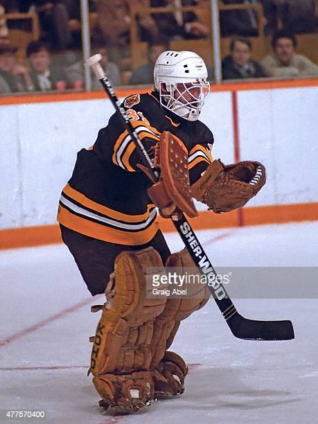Doug Keans of the Boston Bruins stops a shot against the Toronto Maple Leafs during game action at Maple Leaf Gardens in Toronto Ontario Canada on...