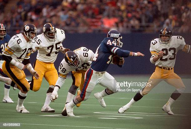 Doug Kotar of the New York Giants carries the ball against the Pittsburgh Steelers during an NFL football game October 24 1976 at The Meadowlands in...