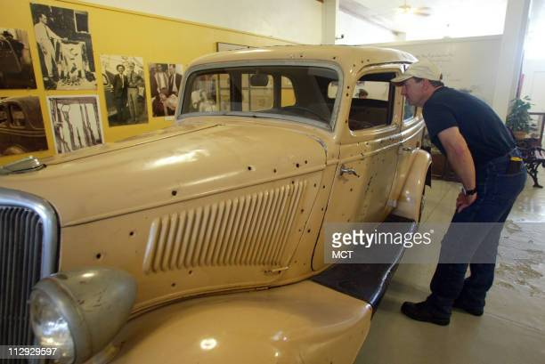 Doug Kratzer of Etoile Texas takes a good look at the replica Bonnie and Clyde getaway car a 1934 Ford fourdoor delux V8 at the Bonnie Clyde Ambush...
