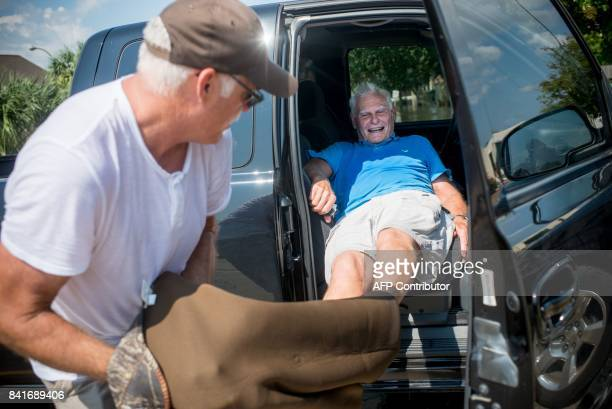 Doug Leblanc pulls off his father's John Leblanc's waders after starting to clean out John's flooded home in Port Arthur Texas September 1 2017...