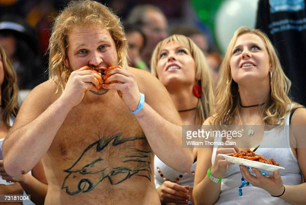 Doug Les Petocle of Valley Forge, Pennsylvania competes and feigns vomiting during Wing Bowl 15 February 2, 2007 in Philadelphia, Pennsylvania. About...