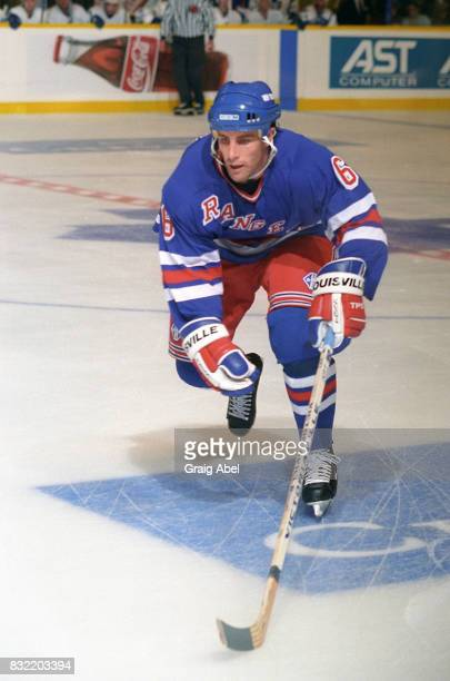 Doug Lidster of the the New York Rangers skates up ice against the Toronto Maple Leafs during NHL game action on October 14 1995 at Maple Leaf...