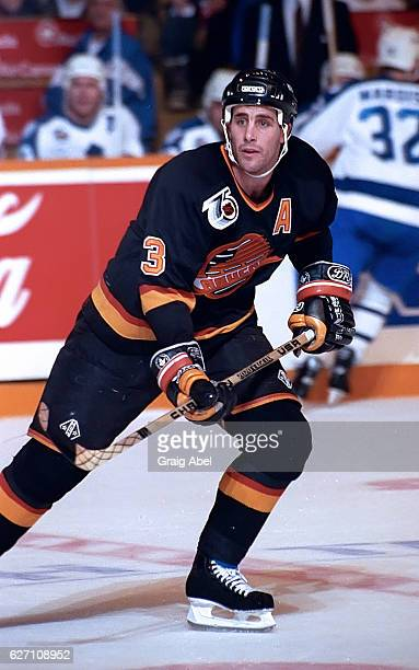 Doug Lister of the Vancouver Canucks watches the play develop against the Toronto Maple Leafs during NHL game action on December 7 1991 at Maple Leaf...