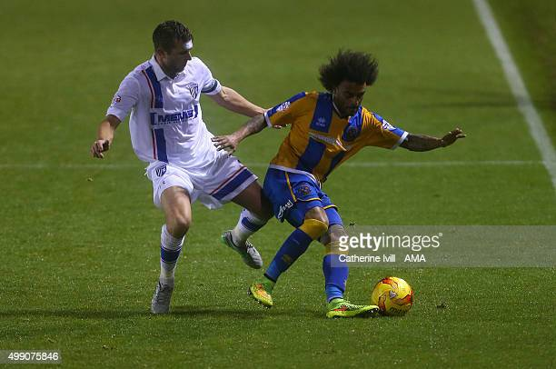 Doug Loft of Gillingham and Junior Brown of Shrewsbury Town during the Sky Bet League One match between Shrewsbury Town and Gillingham at New Meadow...