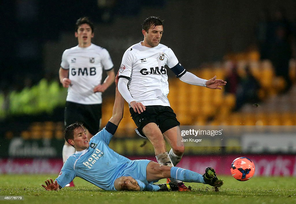 Doug Loft of Port Vale is tackled by Conor Hourihane of Plymouth Argyle during the Budweiser FA Cup third round match between Port Vale and Plymouth Argyle at Vale Park on January 5, 2014 in Burslem, England.