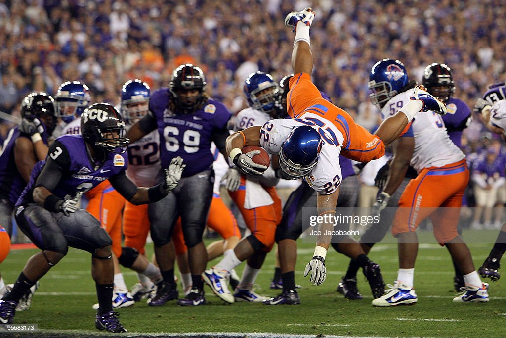 Doug Martin #22 of the Boise State Broncos scores on a two-yard touchdown run in the fourth quarter against the TCU Horned Frogs during the Tostitos Fiesta Bowl at the Universtity of Phoenix Stadium on January 4, 2010 in Glendale, Arizona.