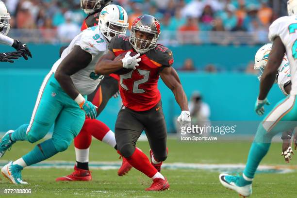 Doug Martin of the Bucs runs the ball during game between the Tampa Bay Buccaneers and the Miami Dolphins on Sunday Nov 19 2017 at Hard Rock Stadium...
