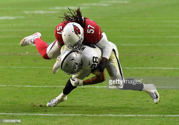 Doug Martin of the Oakland Raiders is tackled by Josh Bynes of the Arizona Cardinals at State Farm Stadium on November 18, 2018 in Glendale, Arizona....