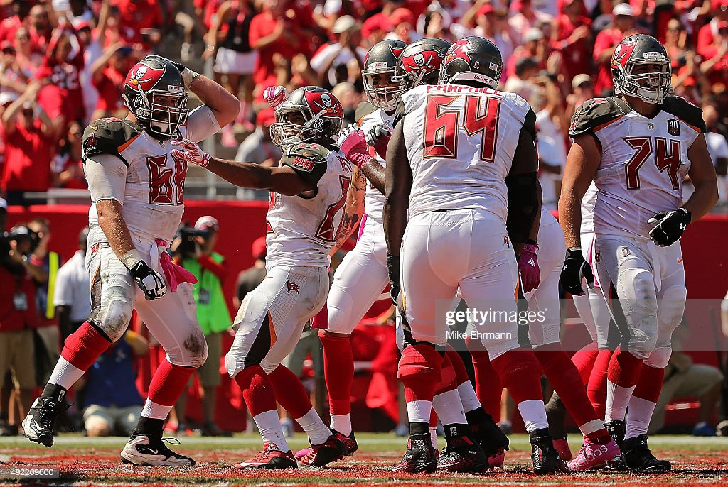 Doug Martin #22 of the Tampa Bay Buccaneers celebrates a touchdown during a game against the Jacksonville Jaguars at Raymond James Stadium on October 11, 2015 in Tampa, Florida.