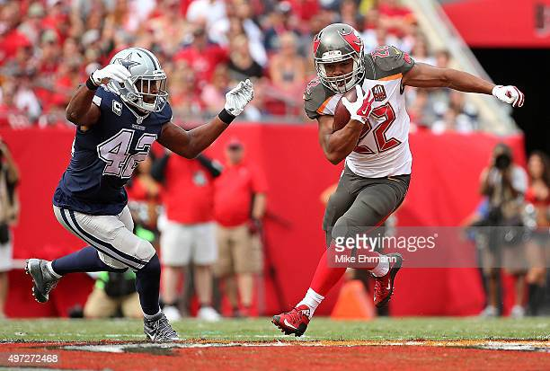 Doug Martin of the Tampa Bay Buccaneers escapes a tackle from Barry Church of the Dallas Cowboys during a game at Raymond James Stadium on November...