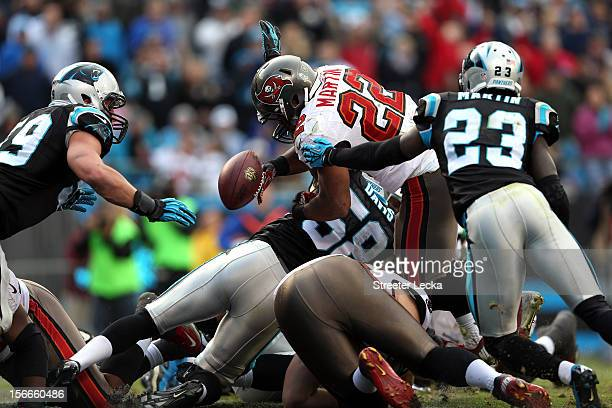 Doug Martin of the Tampa Bay Buccaneers fumbles on the goal line late in the 4th quarter during their game against the Carolina Panthers at Bank of...