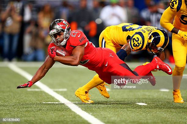 Doug Martin of the Tampa Bay Buccaneers goes down after a hit from Rodney McLeod of the St Louis Rams in the second quarter at the Edward Jones Dome...