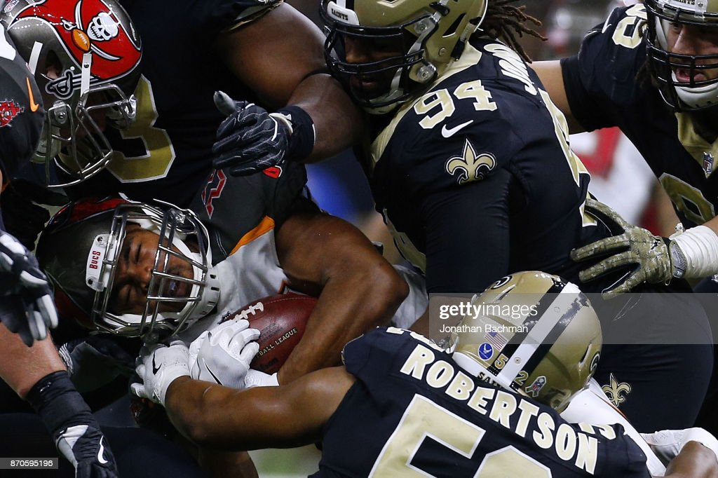 Doug Martin #22 of the Tampa Bay Buccaneers is tackled by the New Orleans Saints defense during the first half of a game at Mercedes-Benz Superdome on November 5, 2017 in New Orleans, Louisiana.