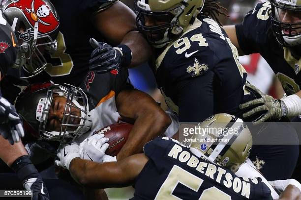 Doug Martin of the Tampa Bay Buccaneers is tackled by the New Orleans Saints defense during the first half of a game at MercedesBenz Superdome on...