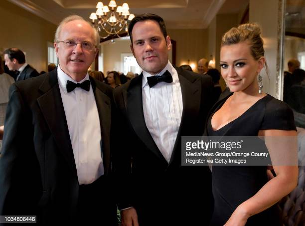 Doug McCrea of Newport Beach left joins retired NHL star Mike Comrie and wife actress Hilary Duff at the Art of Dining benefit for the Orange County...