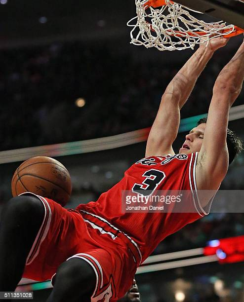Doug McDermott of the Chicago Bulls dunks against the Toronto Raptors on his way to a gamehigh 30 points at the United Center on February 19 2016 in...