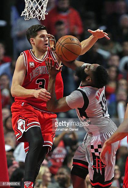 Doug McDermott of the Chicago Bulls fouls James Harden of the Houston Rockets at the United Center on March 5 2016 in Chicago Illinois The Bulls...