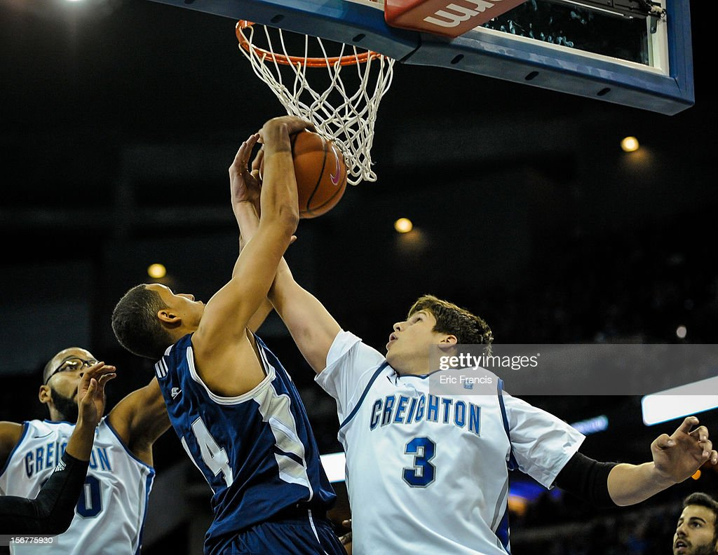 Doug McDermott #3 of the Creighton Bluejays fights for a rebound with Michael Kessens #14 of the Longwood Lancers during their game at CenturyLink Center on November 20, 2012 in Omaha, Nebraska.