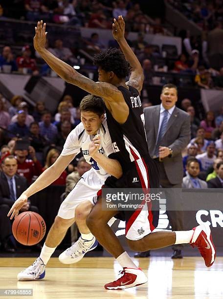Doug McDermott of the Creighton Bluejays handles the ball against Elfrid Payton of the Louisiana Lafayette Ragin Cajuns in the second half as head...