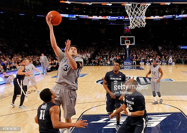 Doug McDermott of the Creighton Bluejays shoots over Dee Davis of the Xavier Musketeers in the first half during the Semifinals of the 2014 Men's Big...