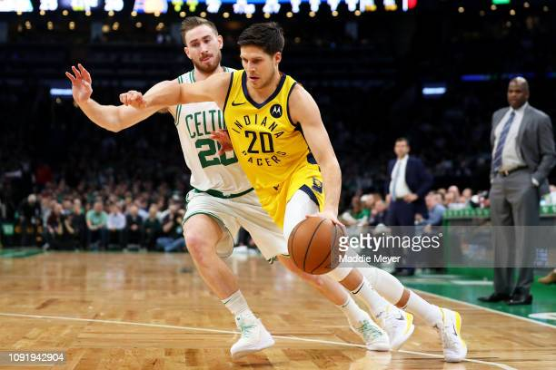 Doug McDermott of the Indiana Pacers drives against Gordon Hayward of the Boston Celtics at TD Garden on January 09 2019 in Boston Massachusetts NOTE...