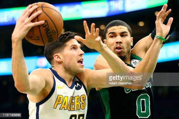 Doug McDermott of the Indiana Pacers drives to the basket past Jayson Tatum of the Boston Celtics during Game One of the first round of the 2019 NBA...