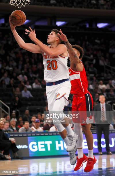 Doug McDermott of the New York Knicks lays up a shot in a preseason NBA basketball game against the Washington Wizards on October 13 2017 at Madison...