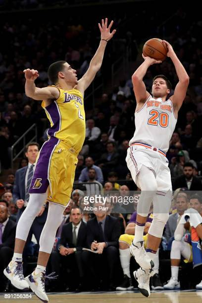 Doug McDermott of the New York Knicks takes a shot against Lonzo Ball of the Los Angeles Lakers in the fourth quarter during their game at Madison...