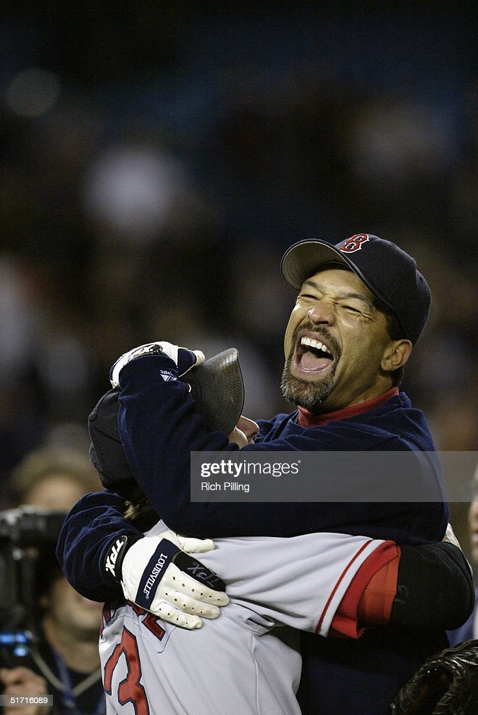 Doug Mientkiewicz and Dave Roberts of the Boston Red Sox celebrate after winning game seven of the ALCS against the New York Yankees at Yankee Stadium on October 20, 2004 in the Bronx, New York. The Red Sox defeated the Yankees 10-3 to win the series four games to three.