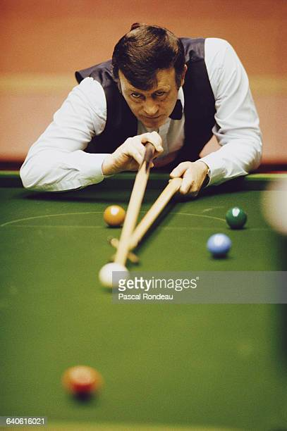 Doug Mountjoy of Wales lines up the cue ball during his World Snooker Championship first round match against Mike Hallett on 15 April 1989 at the...